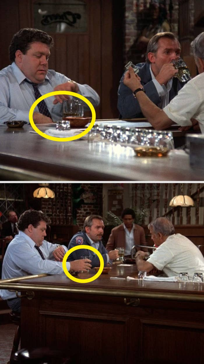 """On """"Cheers,"""" Norm's hand isn't on his glass, but in the next shot it is"""