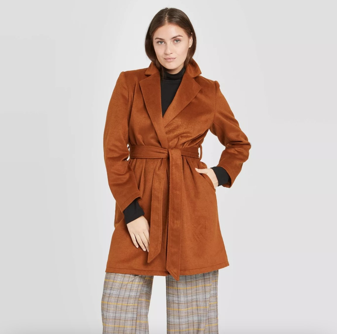 The coat in the color antique wood