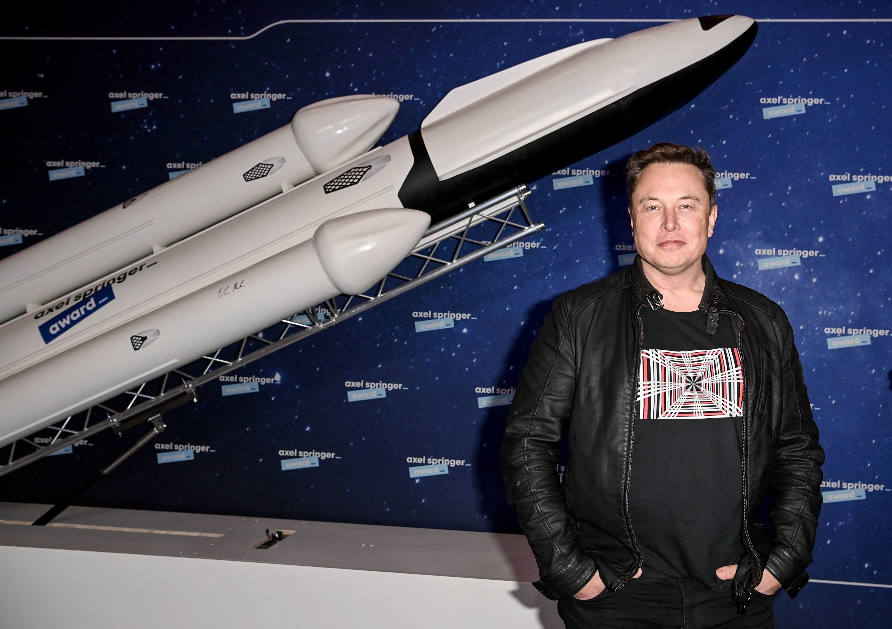 SpaceX owner and Tesla CEO Elon Musk poses as he arrives on the red carpet for the Axel Springer Awards ceremony