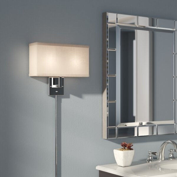 The sconce, which was a silver-tone square mount, and a rectangular shade