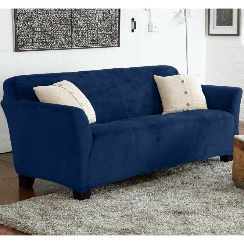 The cover in blue, with elastic edges that hold it in place on the couch
