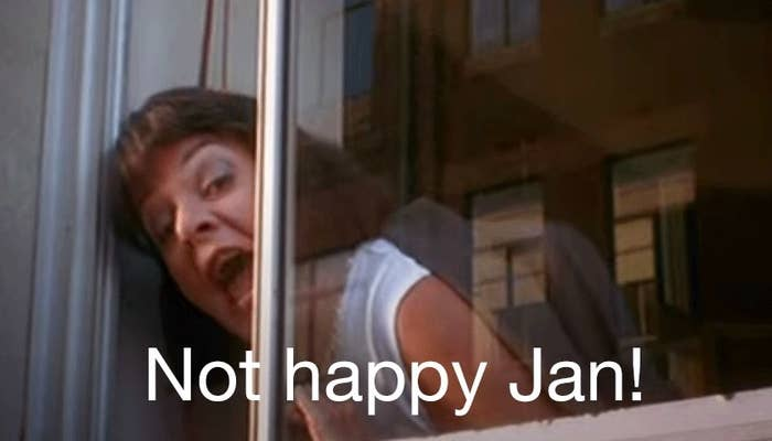 """A woman leans out a window yelling; the caption reads """"not happy Jan!"""""""