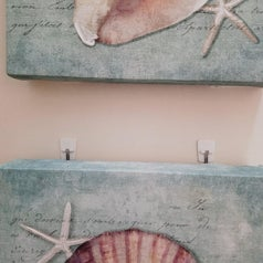 Wall art held up by Command hooks