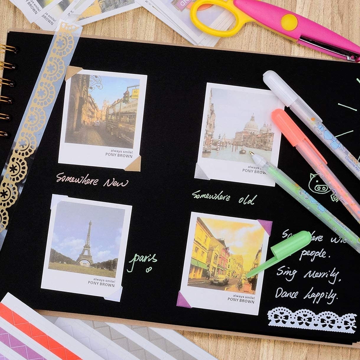 An open scrapbook with four photos pasted to the paper