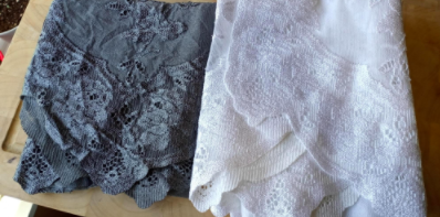 reviewer pic of a dark gray dyed lace curtain beside another white lace curtain that isn't dyed