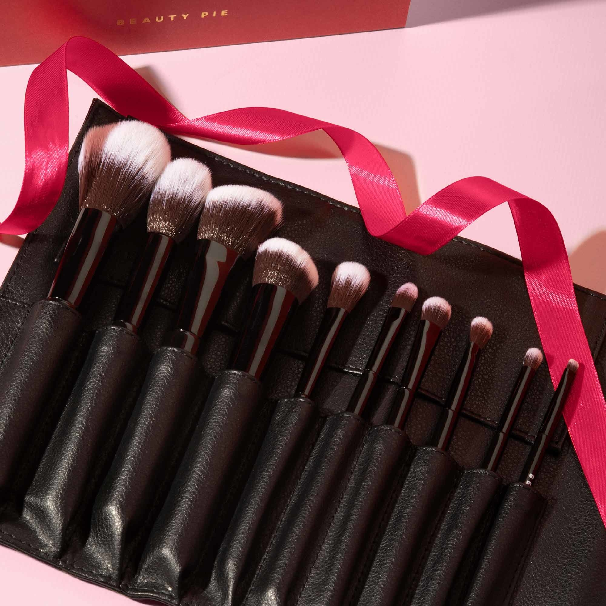 10 piece makeup brush kit on table