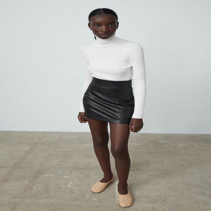 Front view of a model wearing the skirt in black
