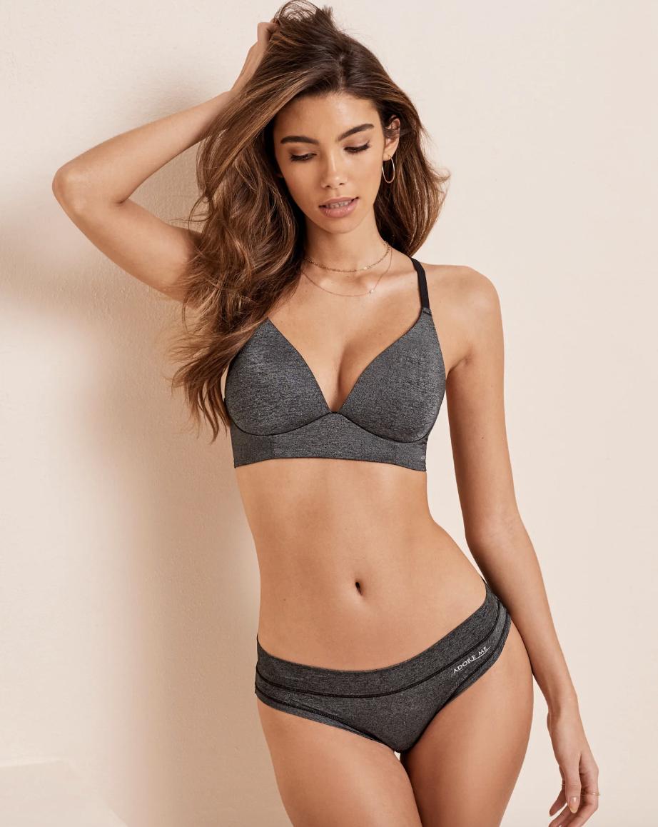 Model in gray strapped bra and underwear