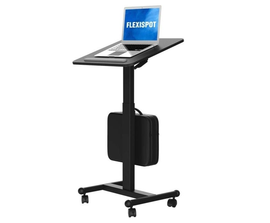 the flexispot laptop standing desk with a laptop on it