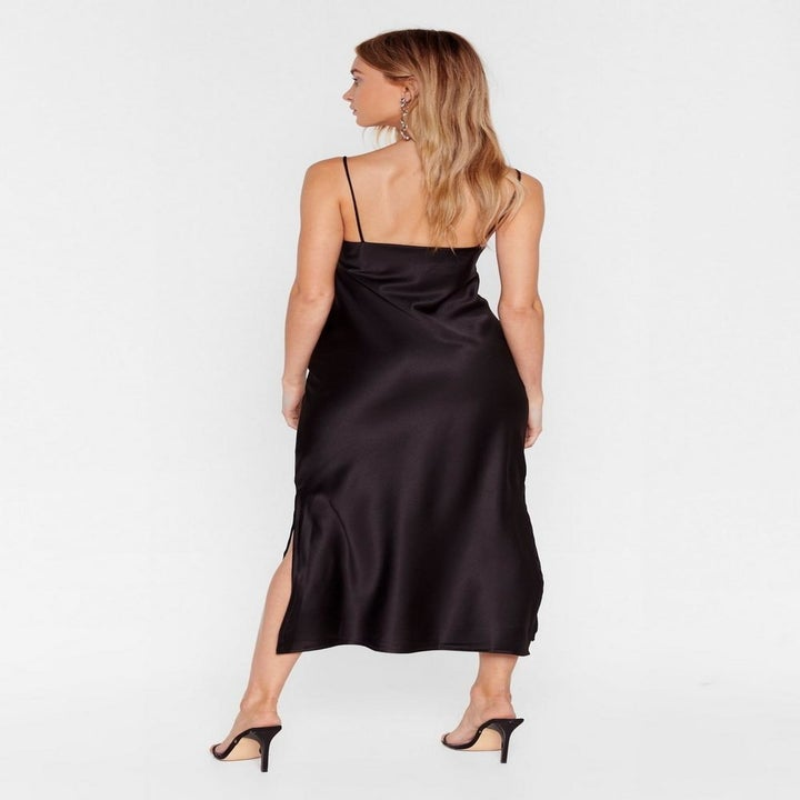 Back view of a model wearing the black slip dress