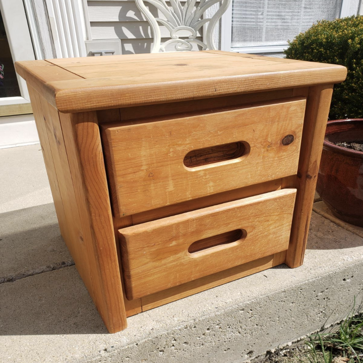 a reviewer photo of a worn-out looking wooden dresser