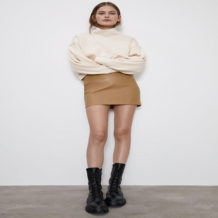 Front view of a model wearing the skirt in taupe