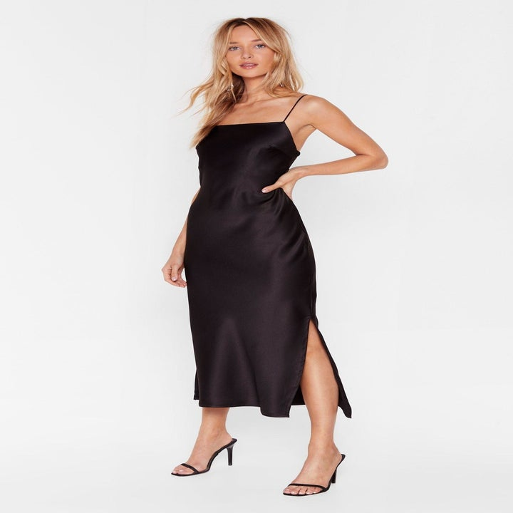 Front view of a model wearing the black slip dress