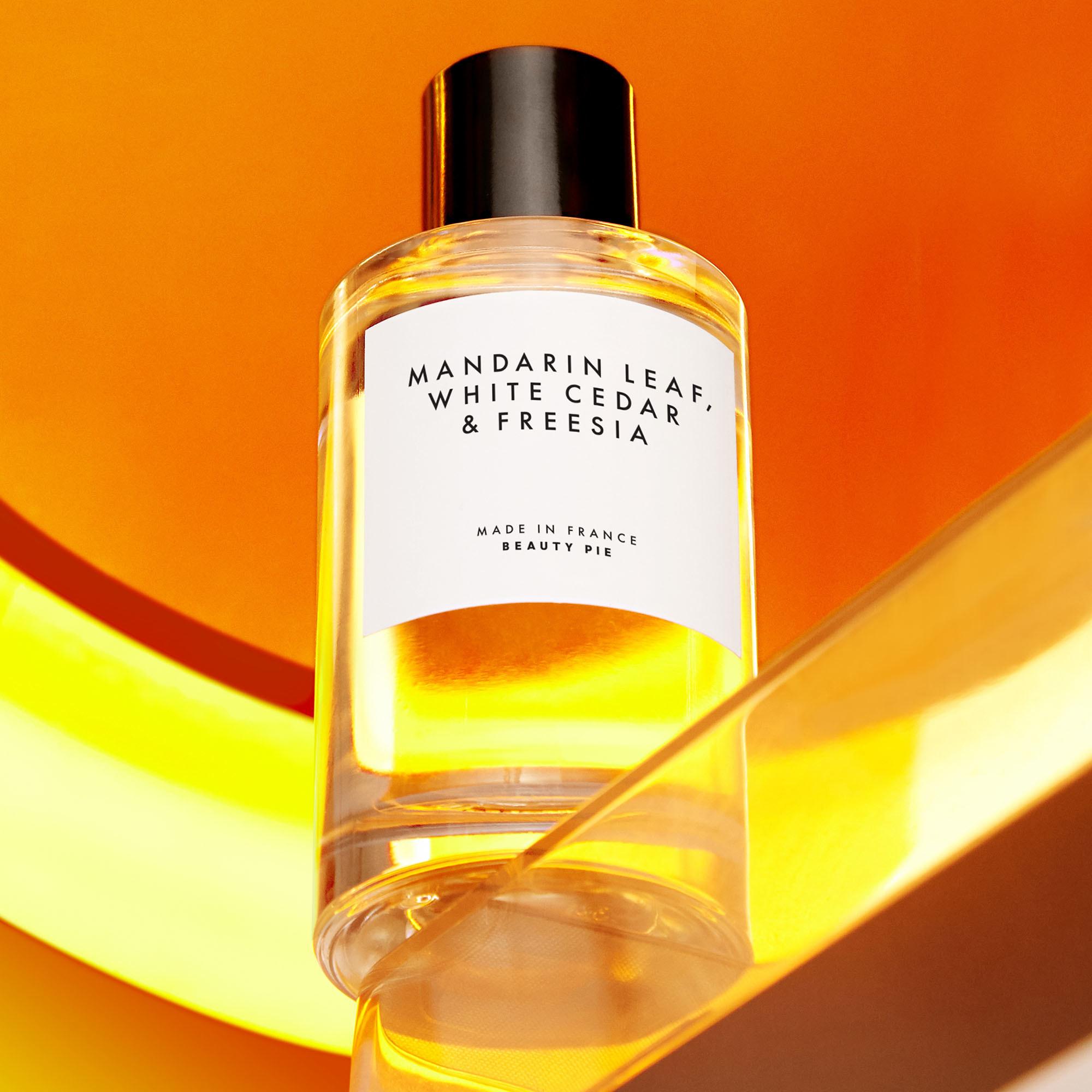 Bottle of fragrance on table