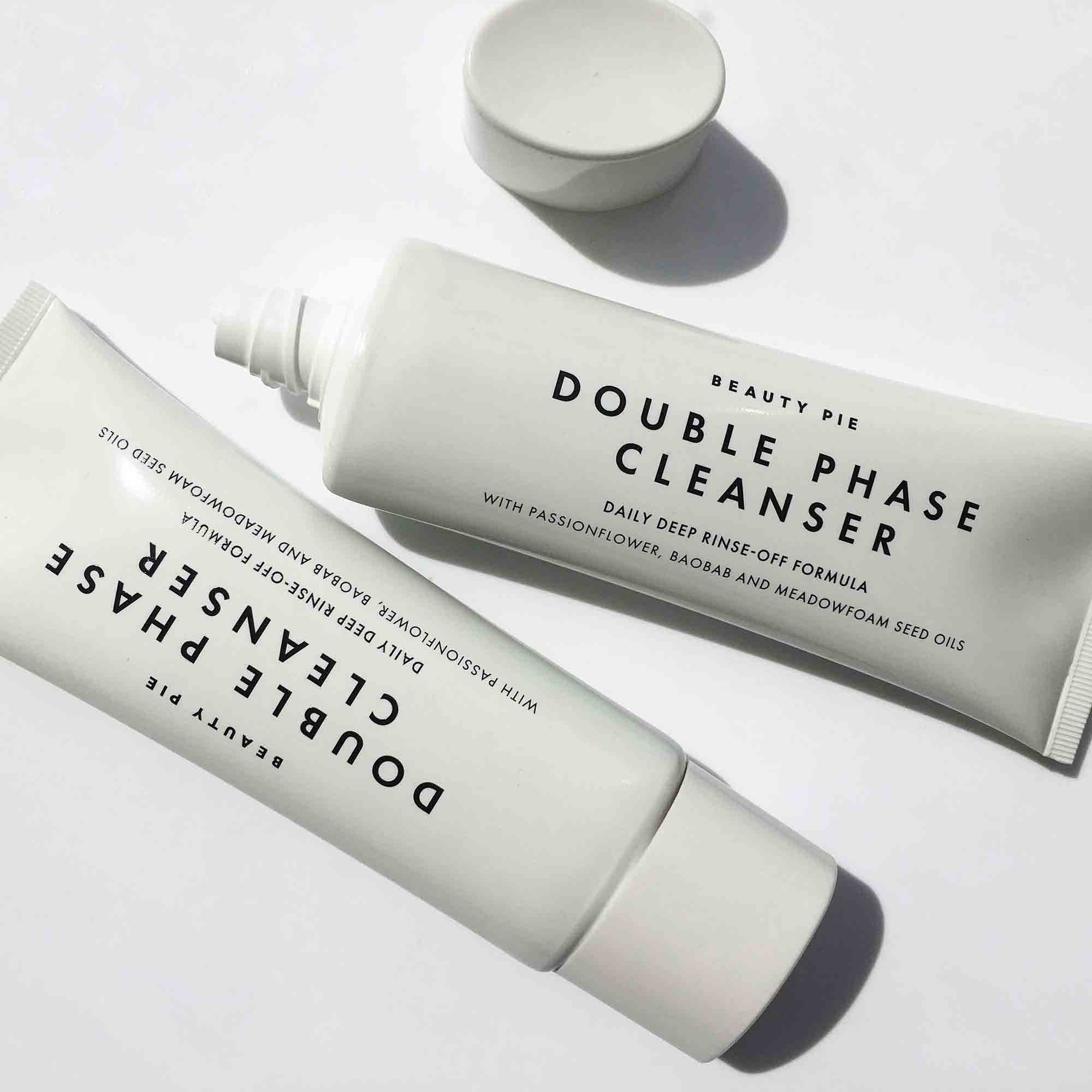 Two tubes of cleanser on white background
