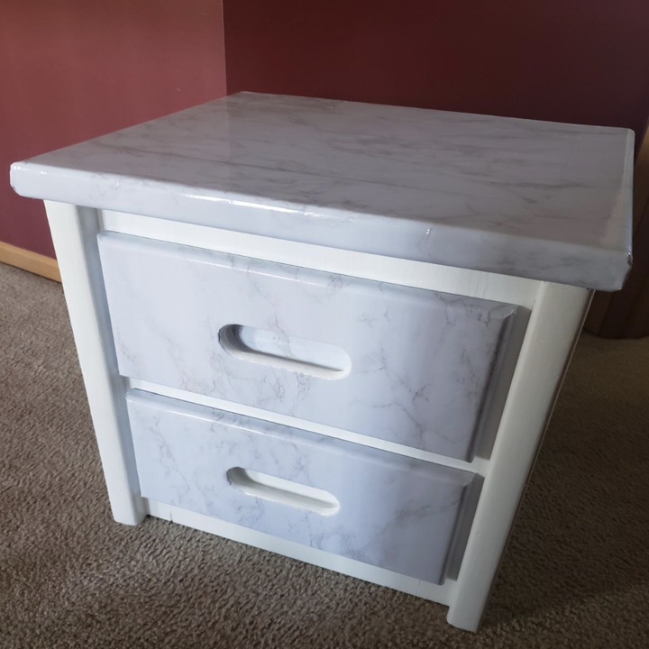 the same dresser looking brand new with the surface cover and white paint