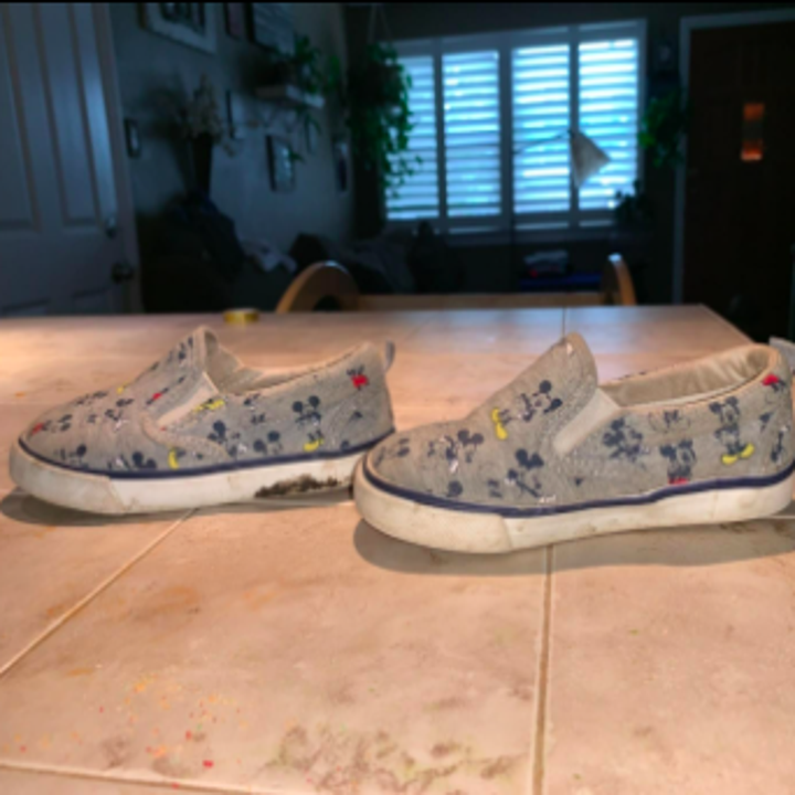 reviewer pic of kid's sneakers with white soles that are very dirty