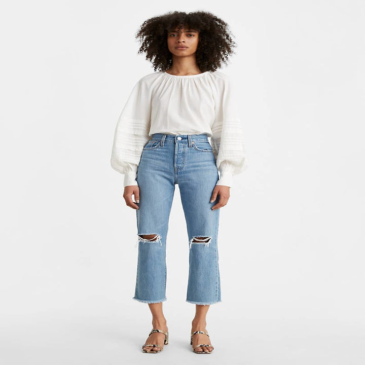 Front view of a model wearing the jeans in market street medium wash