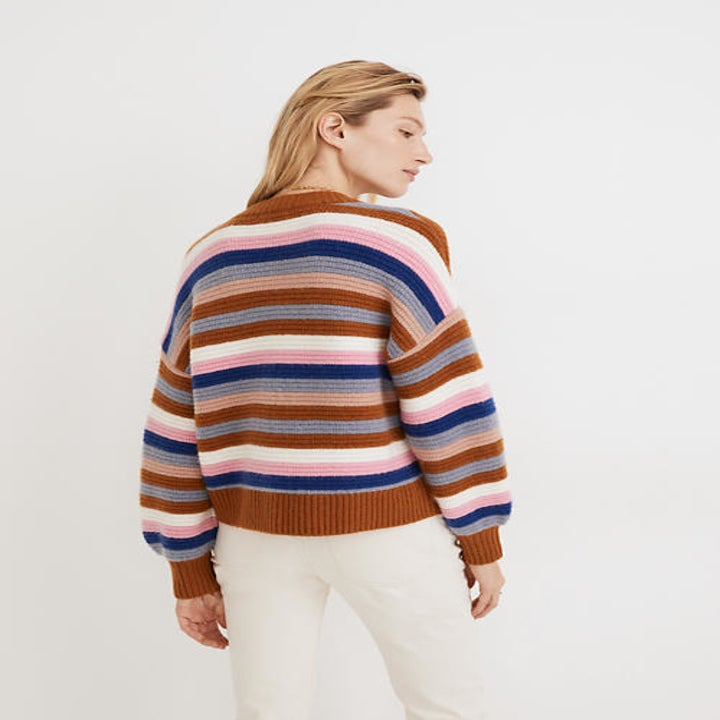 Back view of a model wearing the striped cardigan