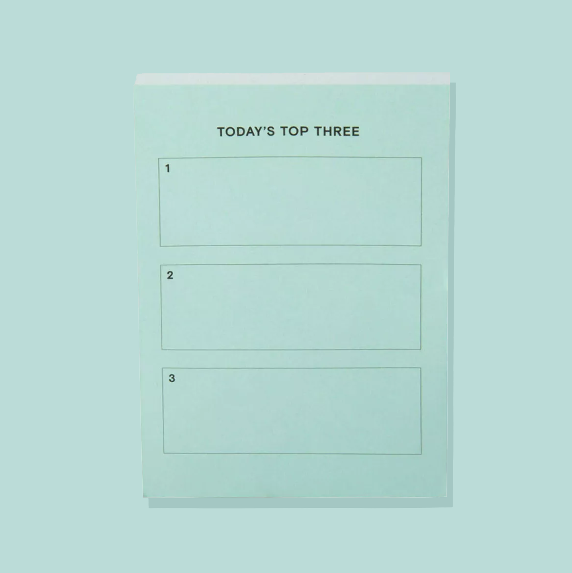 notepad that has three spaces and says today's top three