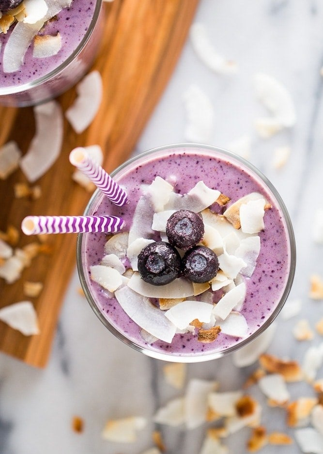 A purple-colored banana, blueberry, and coconut smoothie.