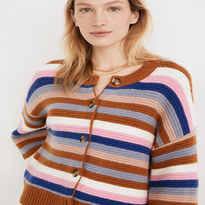 Front view of a model wearing the striped cardigan
