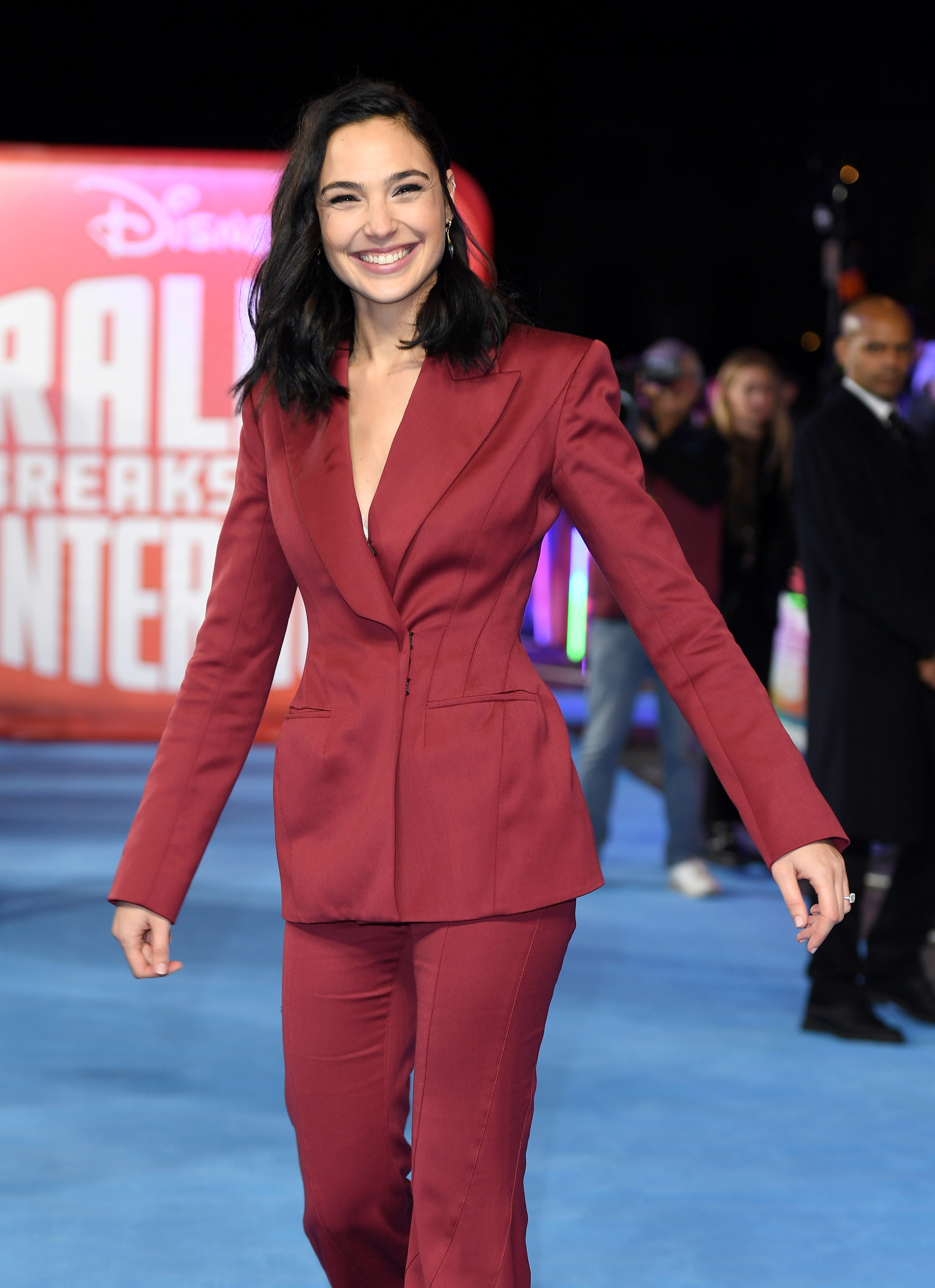 Gal Gadot wearing a red suit at the premiere of Ralph Breaks the Internet