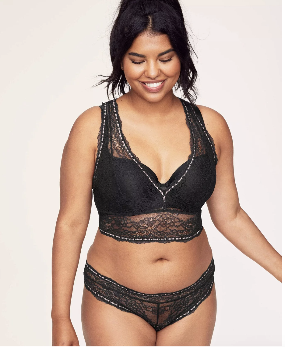 Model in black lacy bralette and matching underwear