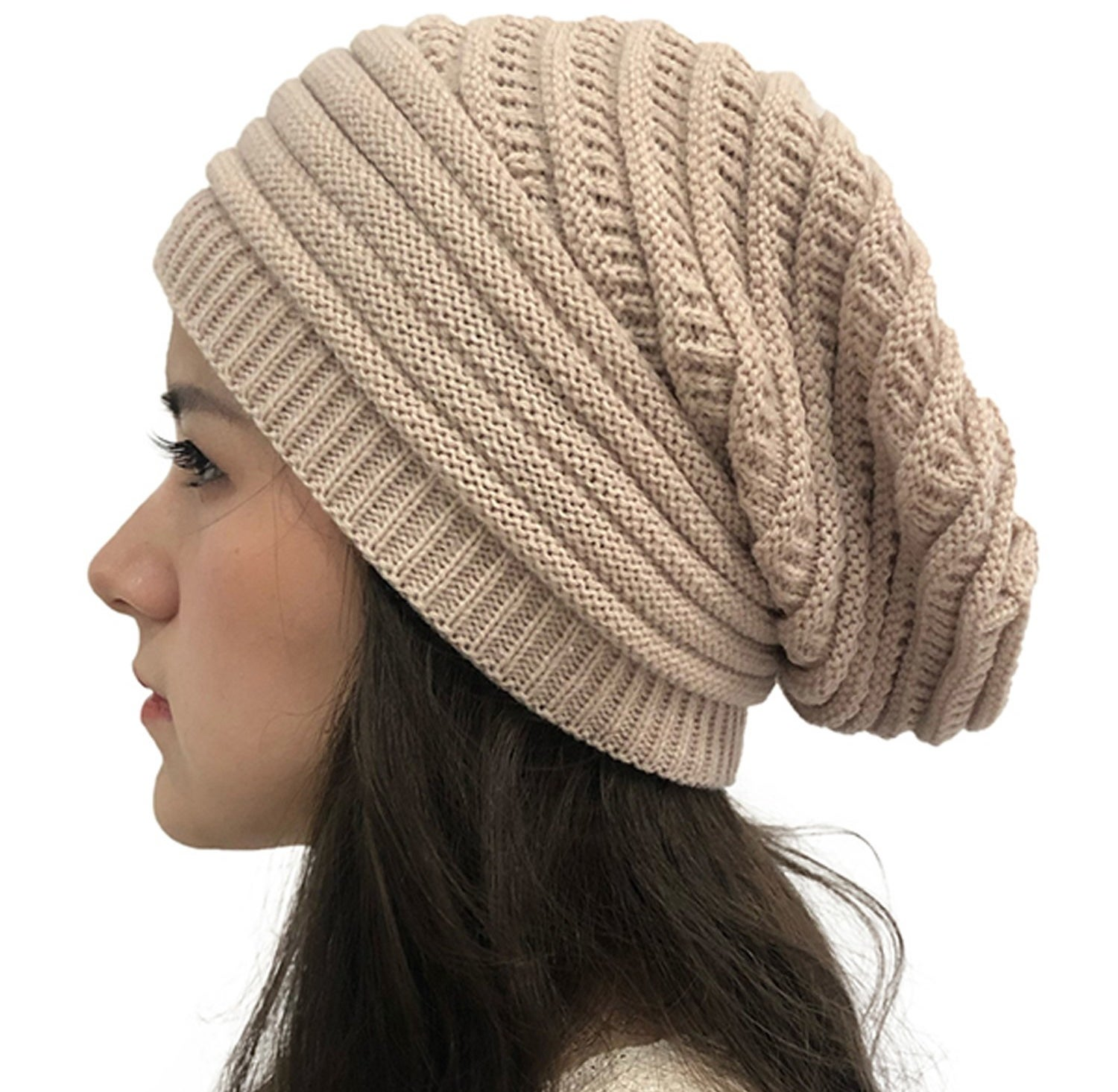 A close up of the beanie worn by a model