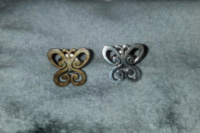 one very tarnished butterfly earring and one new looking silver earring