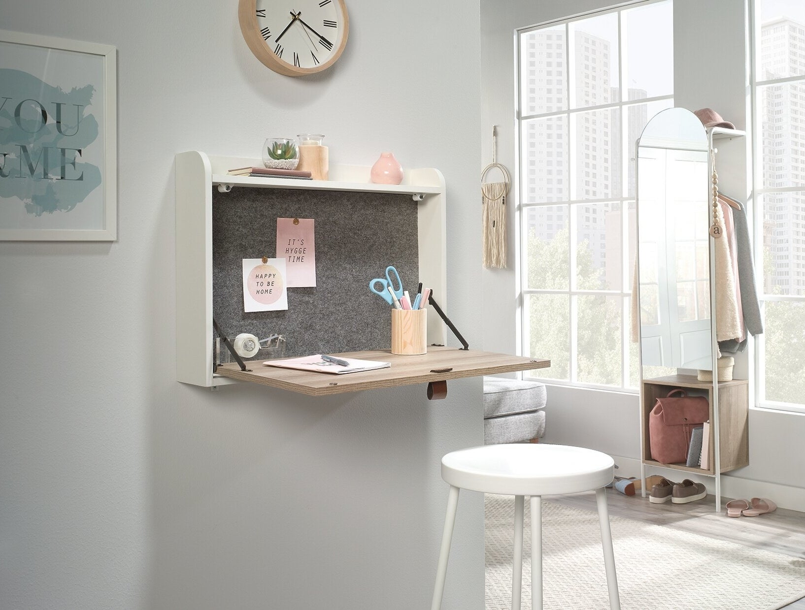 the hashtag home brantley floating desk mounted to a wall in a living space