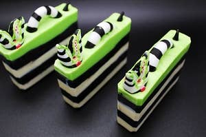 black and white striped soap with green top layer and sandworm coming out of the top