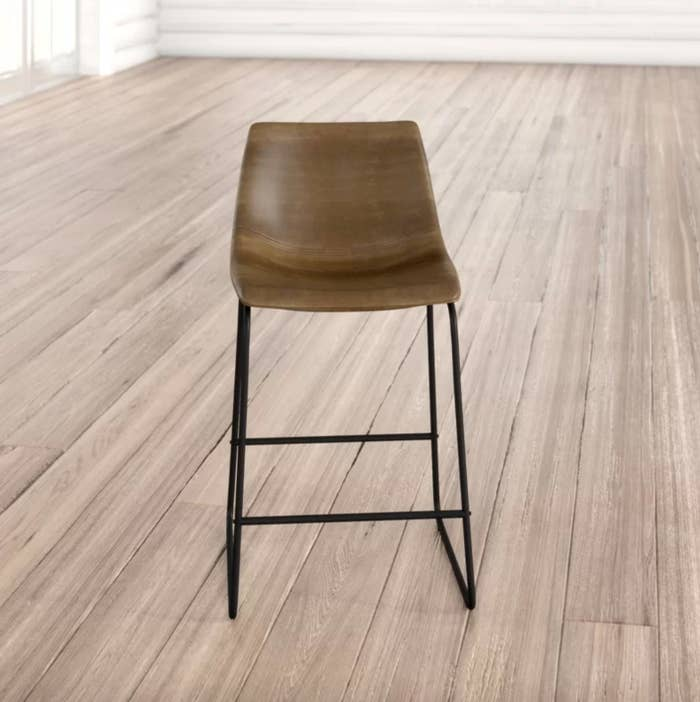 The bar stools in brown