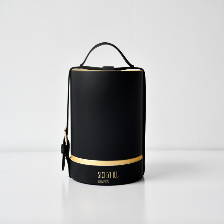 the black leather handbag carrying package for the candle