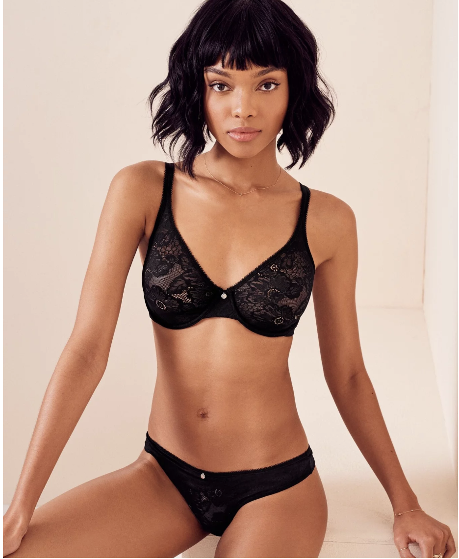Model in black lace strapped full coverage bra with matching underwear