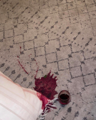 red wine spilled on a light gray rug
