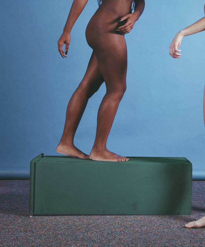 The lower half of a woman walking naked on a fallen pedestal