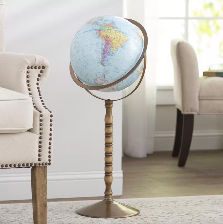 The world globe on a brass stand