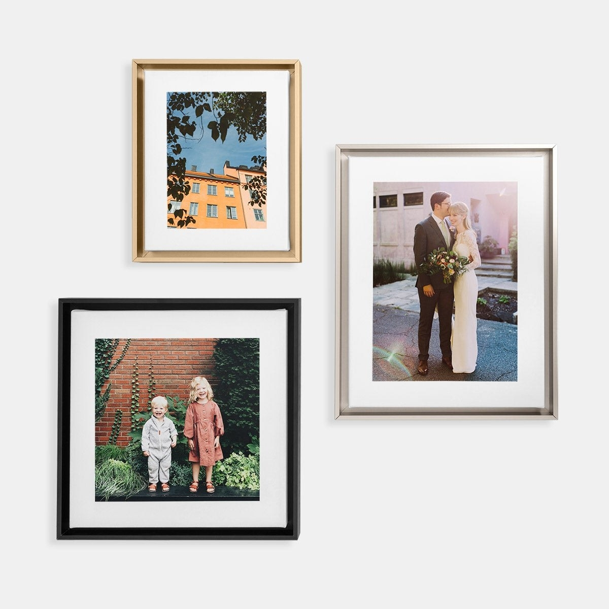 three frames, one in a black frame, one in a brass frame, and one in a silver frame in various sizes
