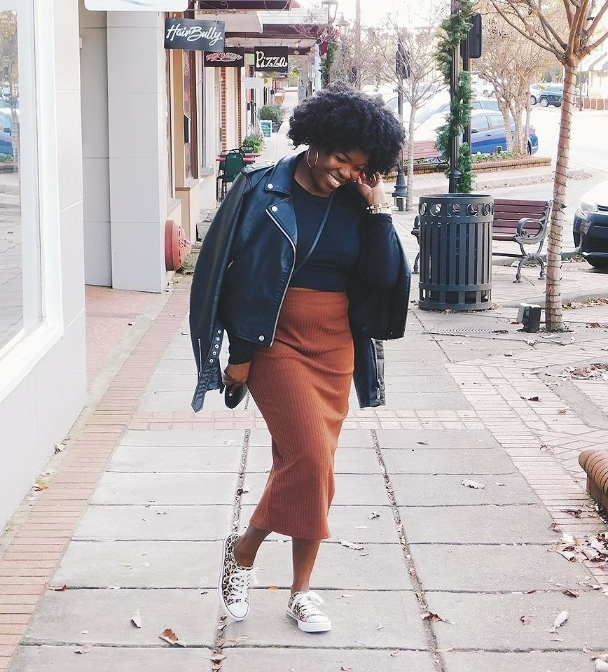 A reviewer wearing the skirt in brown