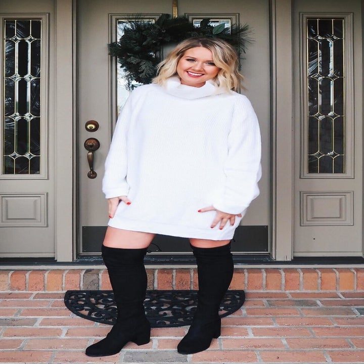 A reviewer wearing the dress in white
