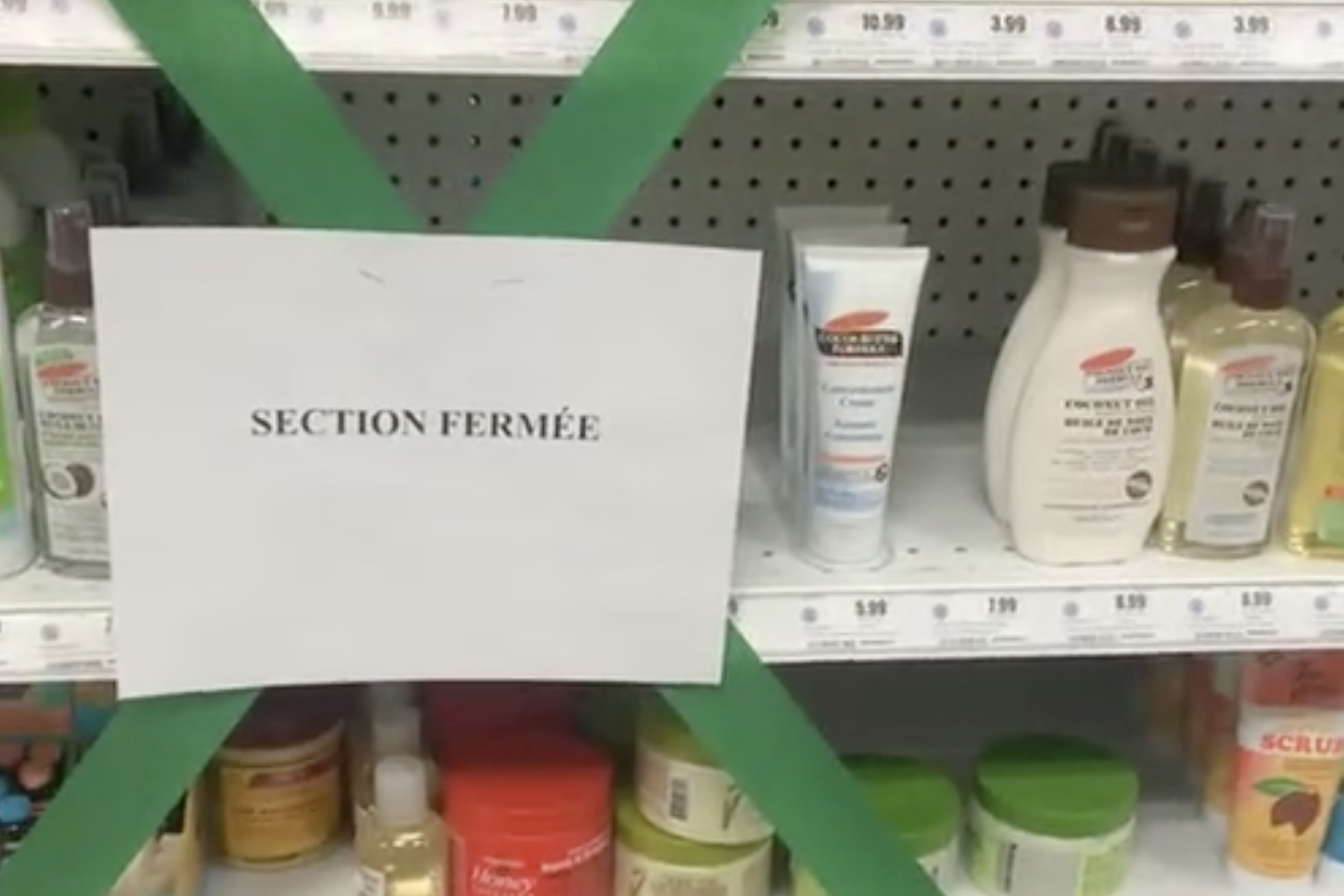 A shelf of products for Black haircare at a Uniprix store with a sign saying the section is closed.