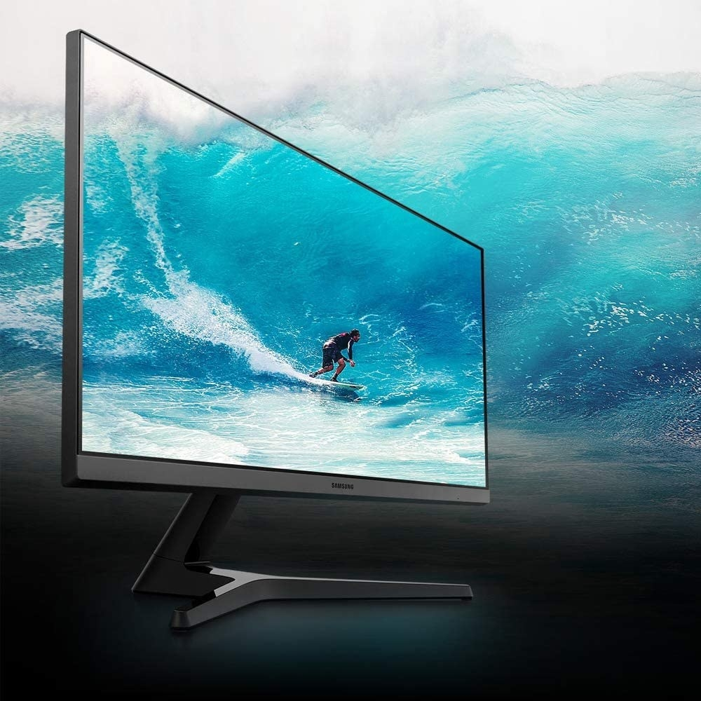 the monitor with a person surfing on it