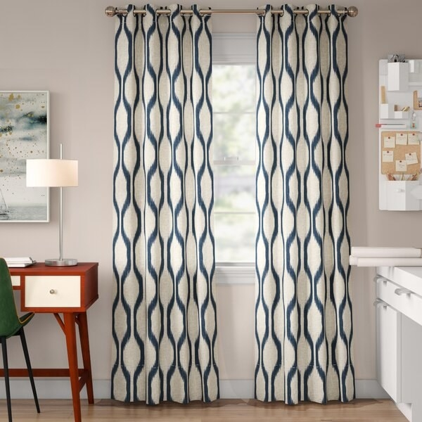 The curtains, which have an ivory base, and a geometric print in blue