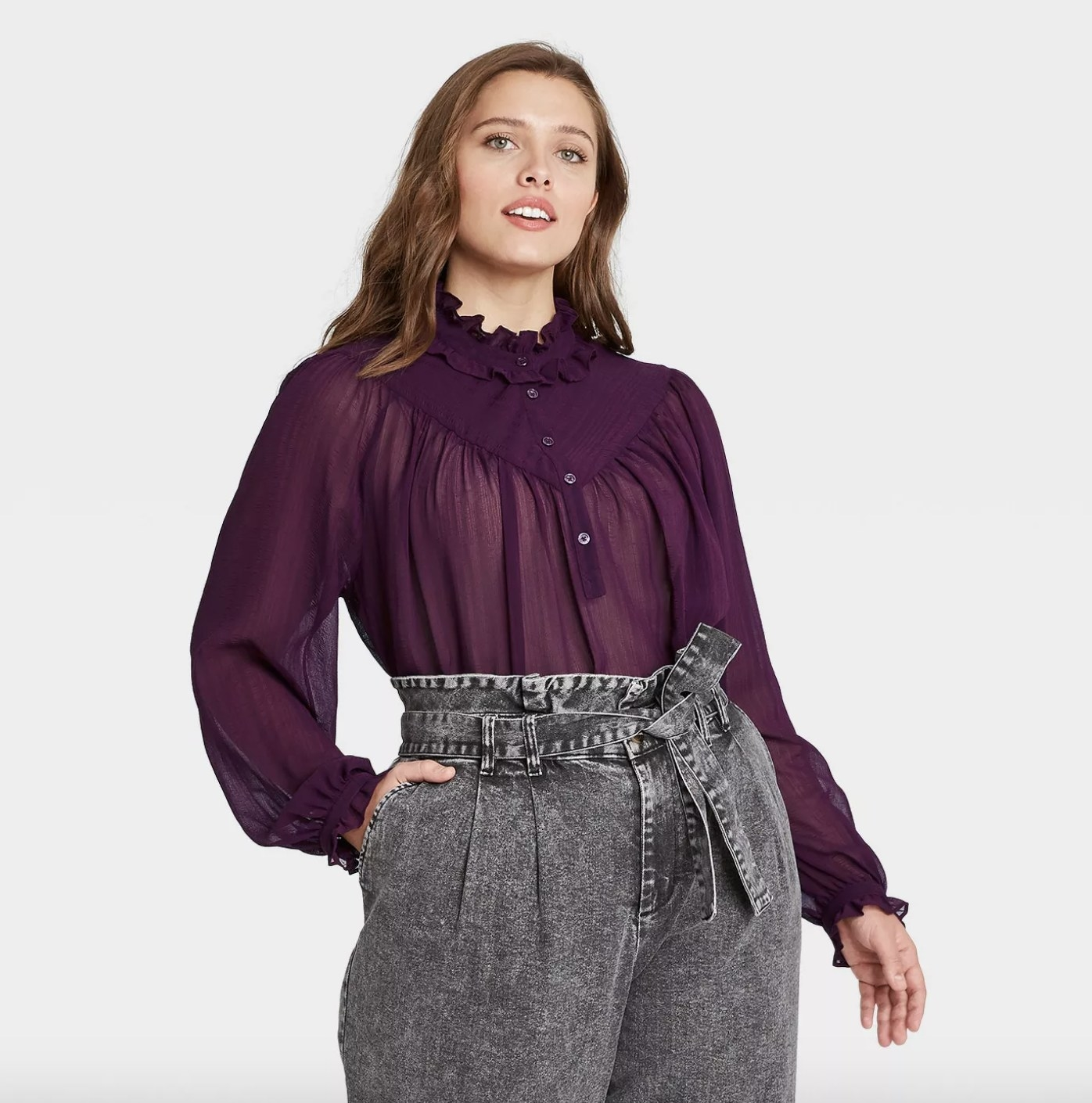 a purple blouse with sheer detailing