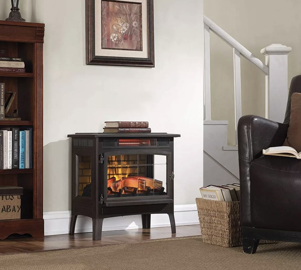 The stove in a living space in a dark wood color