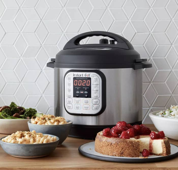 The Instant Pot surrounded by food dishes
