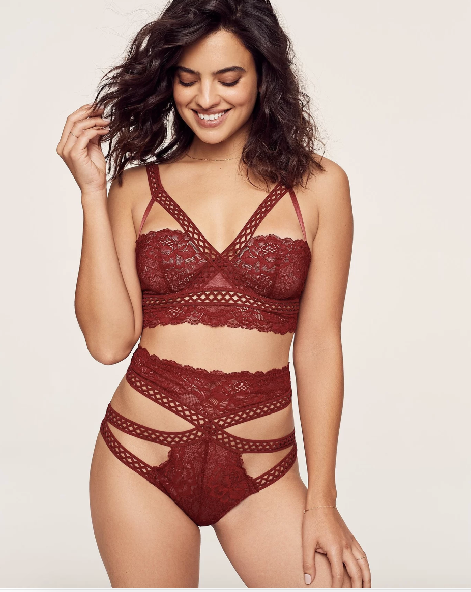 Model in rest strappy lace bra and matching high waisted strappy underwar