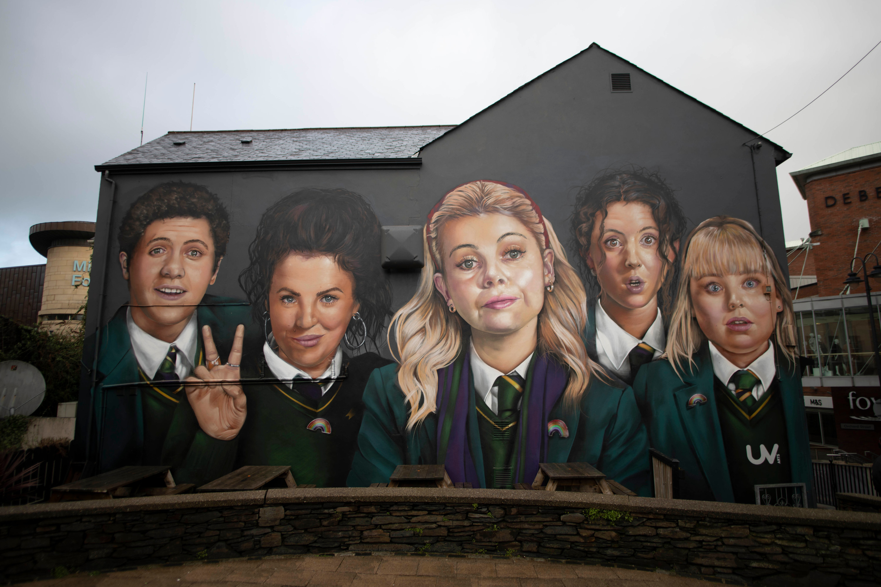 """A mural in Derry, Ireland that depicts the main cast of """"Derry Girls"""""""