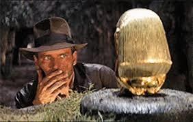 Indiana Jones staring at a golden idol.